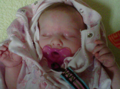 Rhema sleeps while she is getting ready for bed