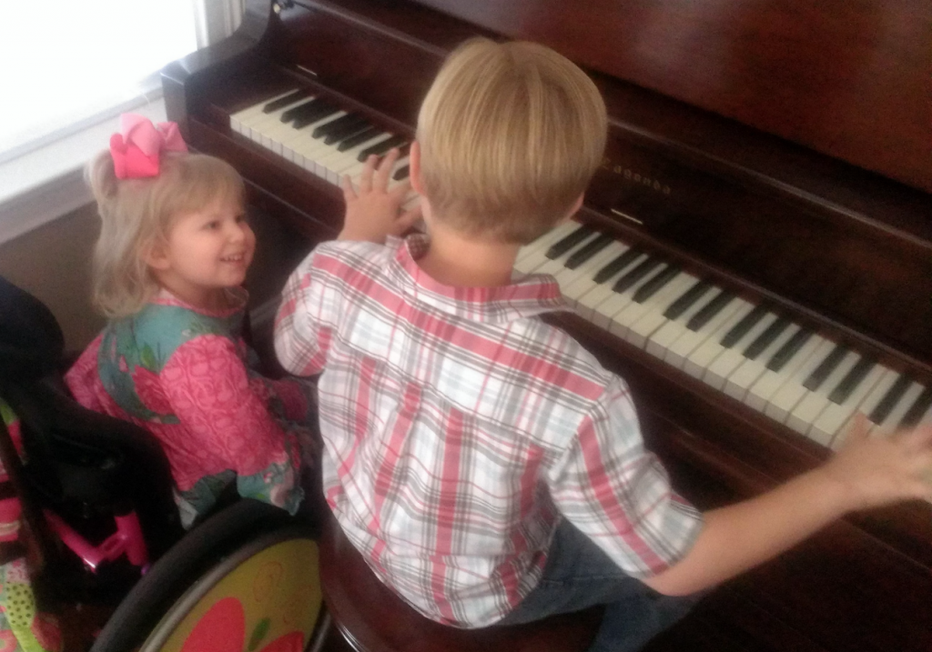Andrew & Rhema Playing Big Momma's Piano March 2014 SNAG-0000