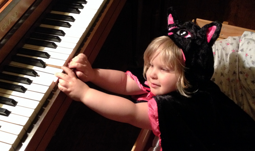 Rhema Kitty Playing Piano May 2014 SNAG-0005