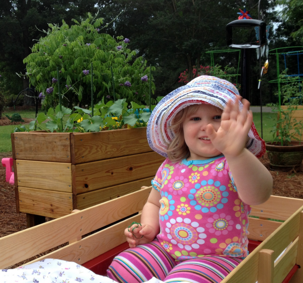 Garden wearing momma's hat waving May 2014 SNAG-0003